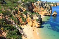 Rocky cliffs on the coast of the Atlantic ocean in Lagos, Algarve, Portugal Stock Photos