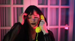 goth woman upset on phone telephone - stock footage