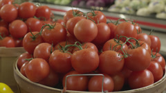 Tomatoes in a grocery store - stock footage