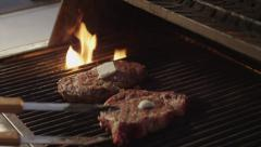 Two steaks grilling - stock footage