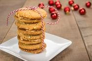 Stock Photo of stack of cookies on white plate with red balls