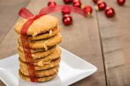 Stock Photo of stack of christmas cookies tied with red ribbon
