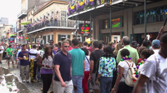 Bourbon street with water puddle during Mardi Gras Stock Footage