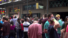 Crowds of people cheering for beads on Bourbon - stock footage