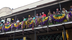 Balcony of people throwing beads during Mardi Gras 2014 Stock Footage