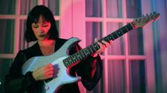 Woman rockstar lady play playing guitar Stock Footage