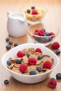 cornflakes with fresh berries for breakfast - stock photo