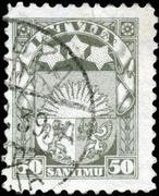 Latvia - circa 1923: a stamp printed in latvia shows latvian coat of arms, ci Stock Photos