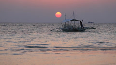 Philippine tourist boat sails on the sea at sunset Stock Footage
