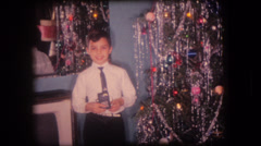Old home movie children with Christmas presents Stock Footage