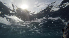Sun Rays and Swirling Foam Underwater by Rock Stock Footage