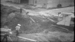 700 - excavator at construction site loading trucks - vintage film home movie Stock Footage
