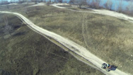 Stock Video Footage of ATV goes on  sandy road. Aerial