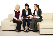 Stock Photo of Three business women discussion on sofa