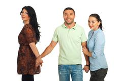 Unfaithful man between two women Stock Photos