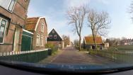 Stock Video Footage of GRAFT-DE RIJP, THE NETHERLANDS vehicle shot narrow street in De Rijp village.