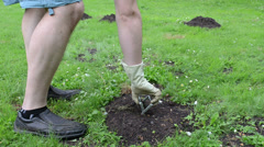 Gardener hand take out empty mole trap equipment Stock Footage