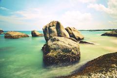 Stones on the sunny beach Stock Photos
