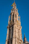 details of asymmetric tower cathedral of our lady in antwerp - stock photo
