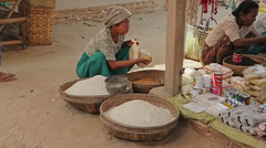 A woman buys rice at the local market - stock footage