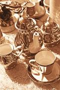 Bric-a-brac market with coffee cups in vintage look Stock Photos