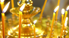Burning candles in church close-up Stock Footage