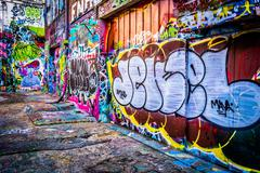 colorful designs in graffiti alley, baltimore, maryland. - stock photo