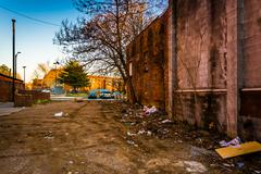 trash and abandoned buildings at old town mall in baltimore, maryland. - stock photo