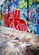 trash and colorful designs in graffiti alley, baltimore, maryland. - stock photo