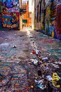 trash in graffiti alley, baltimore, maryland. - stock photo