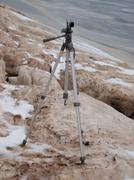 Tripod with the camera standing on an ice floe Stock Photos