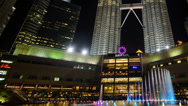 Stock Video Footage of KLCC And Colourful Water Fountain Pan Right