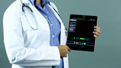 Touch screen medical applications tablet ethnic doctor motion graphics Stock Footage