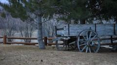 Pan of ran down antique wagon. Stock Footage