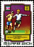 north korea - circa 1978: a stamp printed by north korea shows football playe - stock photo