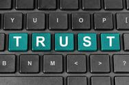 Stock Illustration of trust word on keyboard