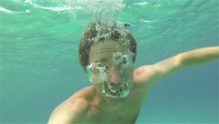 UNDERWATER: Young man making air bubbles Stock Footage