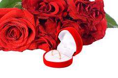 Wedding ring and rose, will you marry me? Stock Photos