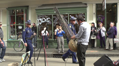 Man playing Kora on New Orleans streets during Mardi Gras Stock Footage
