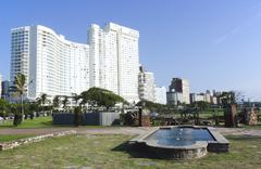 pond in lawn outside hotel on durban beachfront - stock photo