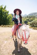 asia women on horseback - stock photo