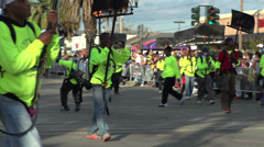 Flambeaux Torch holders walking through Endymion parade Stock Footage