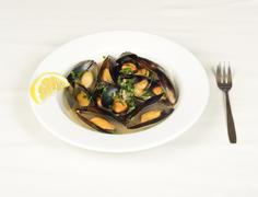 Mussels soup with a piece of lemon. Stock Photos