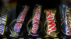 Candy coming out of vending machine Stock Footage