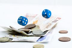 falling dices and money - stock photo