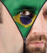 unzipping face to flag of brazil - stock illustration