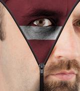 Unzipping face to flag of latvia Stock Illustration