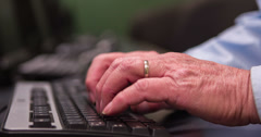 Hands of elderly man using computer at desk 4k Stock Footage