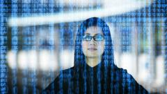 Asian Woman Watching Binary on a Monitor - stock footage