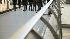 Commuters on millenium bridge Stock Footage